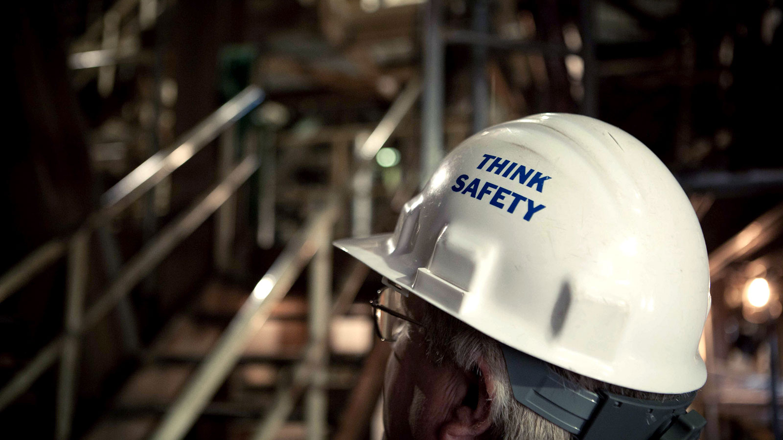Babcock Power employee wearing a hardhat that says 'Think Safety'